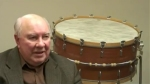 Alan Abel and Bass Drum suspended on his Stand