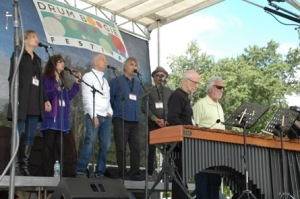 Prana performs with members of NEXUS, Russell Hartenberger and Garry Kvistad, during the opening ceremony.