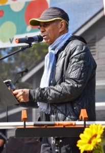Jack DeJohnette reading a poem during the Drum Boogie Festival's opening ceremony